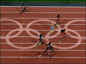 Sanya Richards Ross from the U.S. leads the women's 400-meter final during the athletics competition.