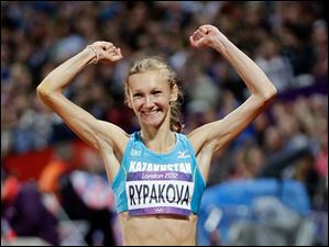 Kazakhstan's Olga Rypakova celebrates winning gold in the women's triple jump final.