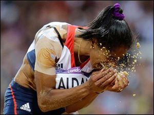 Britain's Yamile Aldama reacts during the women's triple jump final.