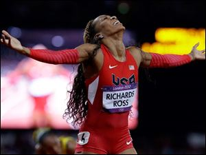 United States' Sanya Richards-Ross celebrates her win in the women's 400-meter final.