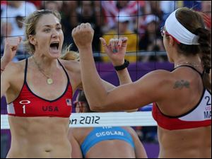 US Kerri Walsh, left, and Misty May-Treanor, right, react during their quarterfinal women's beach volleyball match against Italy.