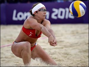 Misty May Treanor of the United States returns a ball during a beach volleyball match against Italy.