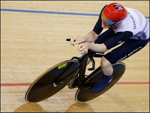 Britain's Edward Clancy races on his way to clinch the bronze medal in the track cycling men's omnium.