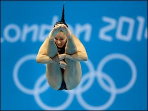 Christina Loukas from the US competes during the women's 3-meter springboard diving final at the Aquatics Centre.