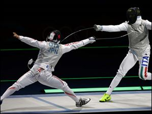 Yuki Ota of Japan competes against Giorgio Avola of Italy, right, during the men's foil team fencing.