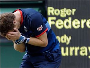 Andy Murray of Great Britain reacts after defeating Roger Federer of Switzerland in the gold medal men's singles match at the All England Lawn Tennis Club in Wimbledon.