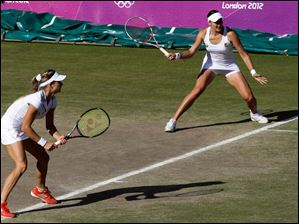 Maria Kirilenko, left, and Nadia Petrova, right, of Russia, play Liezel Huber and Lisa Raymond of the United States in the women's doubles bronze medal match at the All England Lawn Tennis Club at Wimbledon, in London. Petrova and Kirilenko won the medal match.
