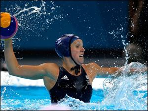 Chloe Wilcox of Britain shoots against Spain during a women's water polo quarterfinal.