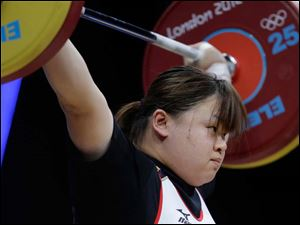 Japan's Mami Shimamoto competes during the women's over 75-kg weightlifting competition.