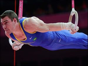 Brazilian gymnast Arthur Nabarrete Zanetti performs on the rings during the artistic gymnastics men's apparatus finals.