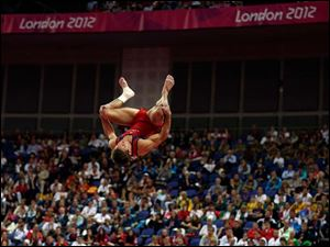 U.S. gymnast Samuel Mikulak performs on the vault during the artistic gymnastics men's apparatus finals.