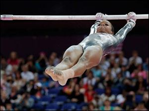 U.S. gymnast Gabrielle Douglas performs on the uneven bars during the artistic gymnastics women's apparatus finals.