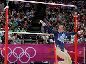 Britain's gymnast Elizabeth Tweddle take a step backwards on dismount.