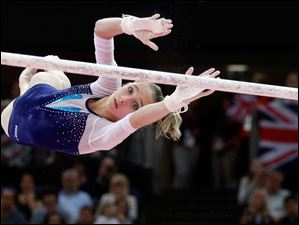 Russian gymnast Victoria Komova performs on the uneven bars.
