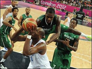 French center Ali Traore tries to score during a men's basketball preliminary round match against Nigeria.