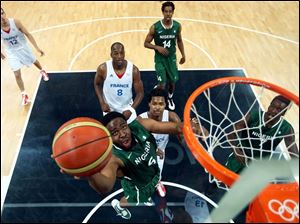 Ike Diogu of Nigeria drives for a shot attempt during a men's basketball preliminary round match against France.