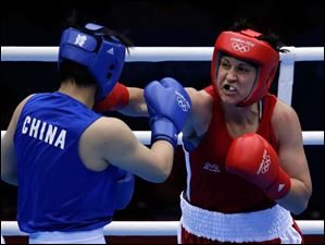 Canada's Mary Spencer, right, fights China's Li Jinzi in a women's middleweight 75-kg quarterfinal boxing match.