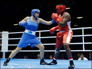 Russia's Nadezda Torlopova, left, fights Nigeria's Edith Ogoke in a women's middleweight 75-kg quarterfinal boxing match.
