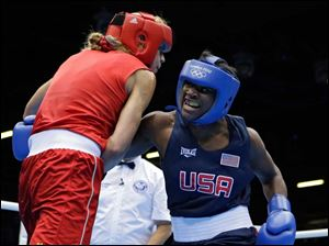 United States' Claressa Shields, right, fights Sweden's Anna Laurell in a women's middleweight 75-kg quarterfinal boxing match.