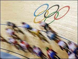 Cyclists compete in the track cycling women's omnium points race event, during the 2012 Summer Olympics.