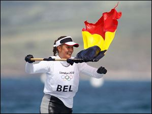 Evi Van Acker of Belgium celebrates her bronze medal during the Laser radial sailing medal race at the London 2012 Summer Olympics.