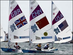 Xu Lijia of China, center, Alison Young of Great Britain, left, and Paige Railey of USA sail during the Laser radial sailing medal race at the London 2012 Summer Olympics.