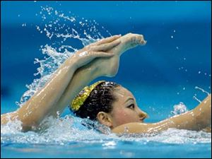 Huang Xuechen and Liu Ou from China compete during the women's duet synchronized swimming free routine at the Aquatics Centre.