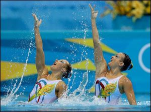 Mary Killman and Mariya Koroleva from the US compete during the women's duet synchronized swimming free routine.