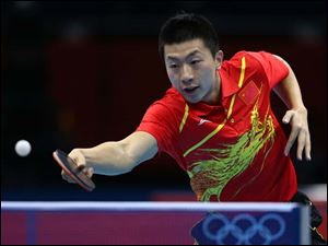 China's Ma Long competes against Germany's Bastian Steger in a men's team table tennis semifinal.