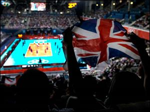Fans cheer during a men's preliminary volleyball match between Britain and Argentina.son)