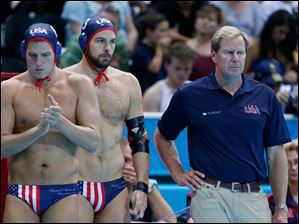 Head Coach of the United States men's water polo team Terry Schroeder, right, watches his team play Hungary during their men's water polo preliminary round match.