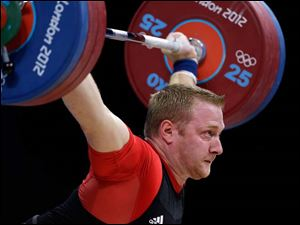 Jurgen Spiess of Germany, competes during men's 105-kg, group B, weightlifting competition.