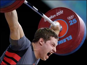 Sergiy Tagirov of Ukraine attempts a lift during men's 105-kg, group B, weightlifting competition.