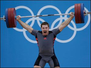 Sergiy Tagirov of Ukraine attempts a lift during the men's 105-kg weightlifting competition.