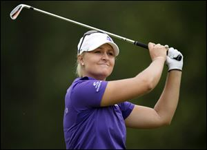 Anna Nordqvist, of Sweden, watches her tee shot on the third hole in the final round of the LPGA Classic golf tournament in Waterloo, Ontario.