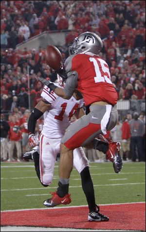 Ohio State's Devin Smith, right, catches the game-winning touchdown as Wisconsin's Marcus Cromartie defends.
