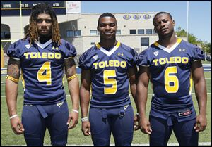 From left, Jordan Haden, Chris Dukes, and Byron Best are hoping to play this season for the Rockets. Dukes and Best are listed as cornerback starters.