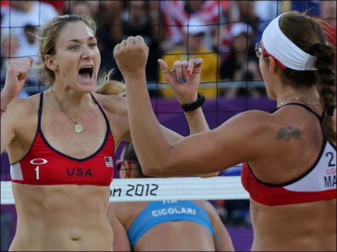 US VB Kerri Walsh Jennings, left, and Misty May-Treanor, right, react during their quarterfinal women's beach volleyball match against Italy Sunday.