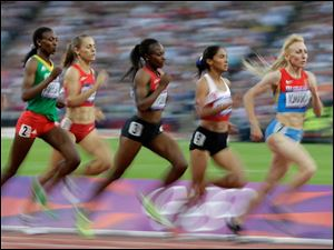 Competitors race in the women's 1500-meter heat.