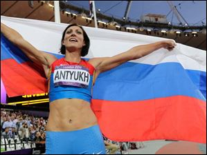 Russia's Natalya Antyukh celebrates after winning gold in the women's 400-meter hurdles final.