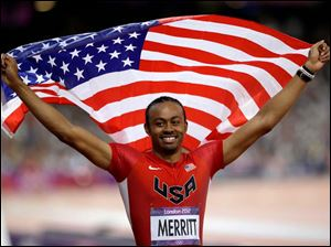 United States'  Aries Merritt celebrates after winning the men's 110-meter hurdles.