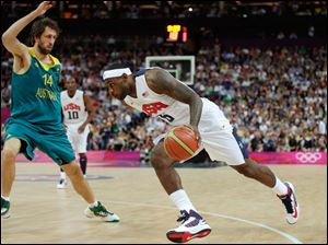 USA's Lebron James, right, drive to the basket against Australia's Matt Nielsen during a men's quarterfinals basketball game.