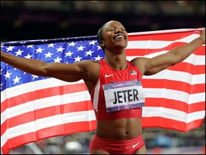 United States' Carmelita Jeter celebrates winning bronze in the women's 200-meter final.