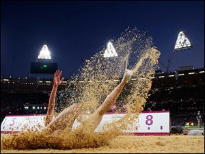 Belarus' Nastassia Mironchyk-Ivanova competes in the women's long jump final.