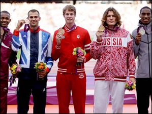 Winners in the men's high jump, from left, bronze medalists Qatar's Mutaz Essa Barshim, Britain's Robert Grabarz ,and Canada's Derek Drouin, Russia's gold medalist Ivan Ukhov, and United States' silver medalist Erik Kynard.