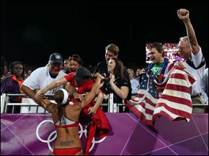 United States' Misty May-Treanor celebrates with her fans and friends after winning the women's gold medal beach volleyball match.