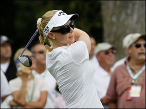 Golfer Morgan Pressel hits a tee shot during the Fathead Celebrity Pro-Am.