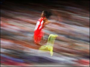 United States' Brittney Reese competes in the women's long jump final to win gold.