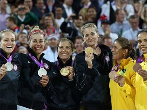 Women's beach volleyball medalists pose with their medals following the Gold Medal match between two United States teams. From left: Silver Medalist Jennifer Kessy and April Ross of the United States. Gold Medalists Missy May Treanor and Kerri Walsh Jennings of the United States and Bronze Medal winners Larissa Franca and Juliana Silva of Brazil.