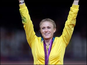 Australia's Sally Pearson celebrates after receiving her gold medal for the women's 100-meter hurdles.